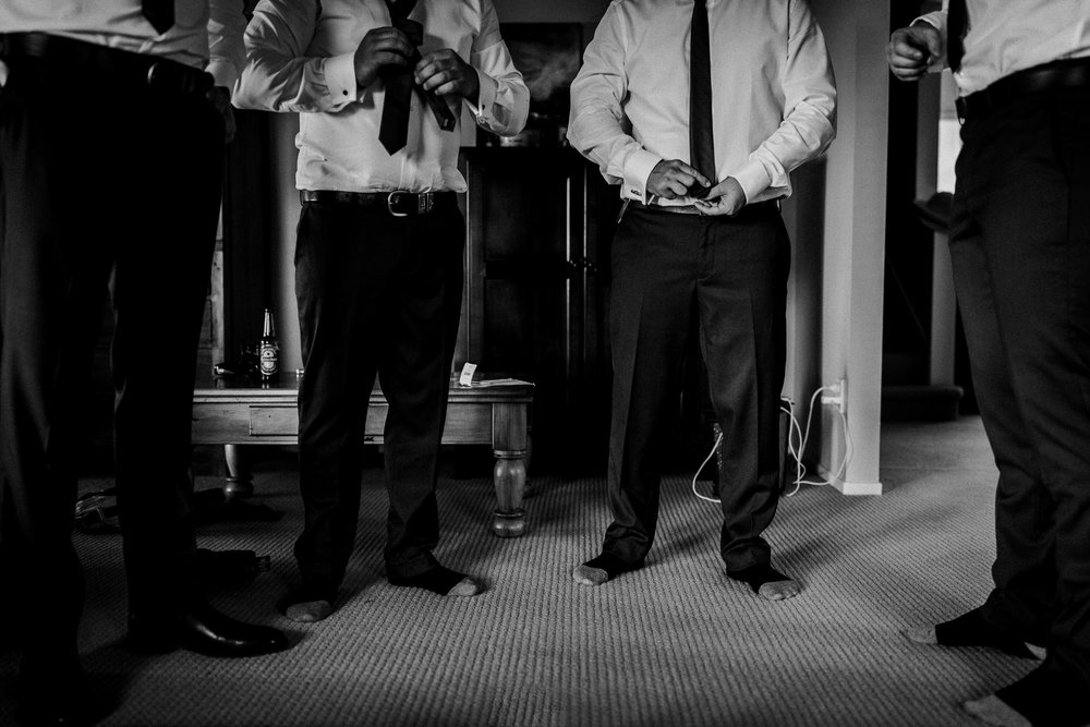 Groomsmen in socks and pants getting ready for NZ wedding