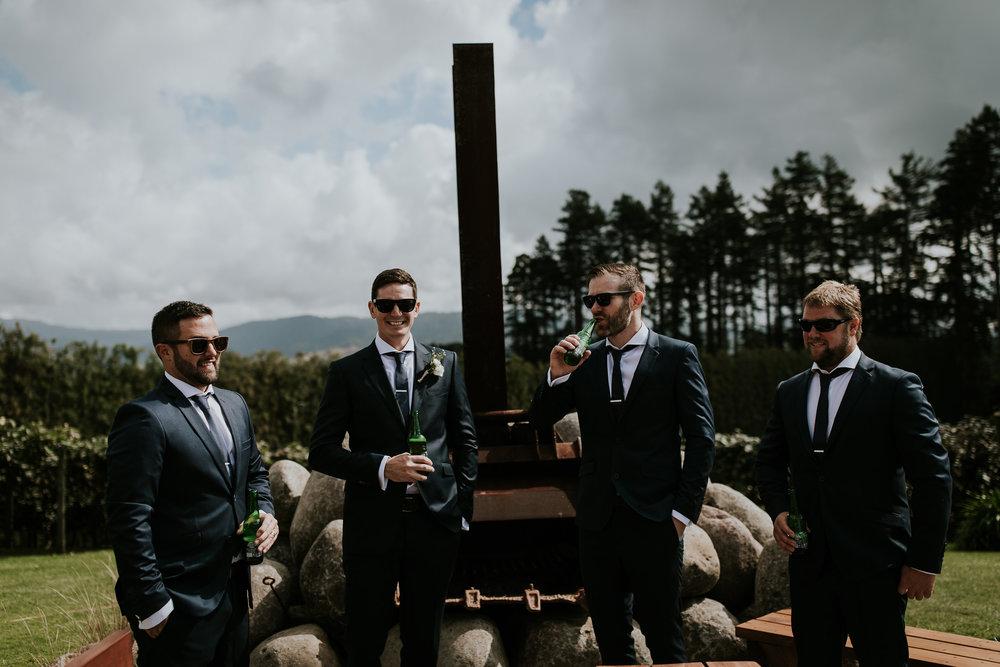 Kiwi groomsmen having some beers with the groom before the wedding starts