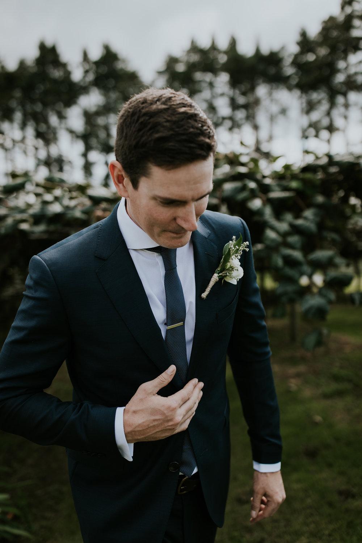 Wedding day portrait of new zealand groom at destination wedding