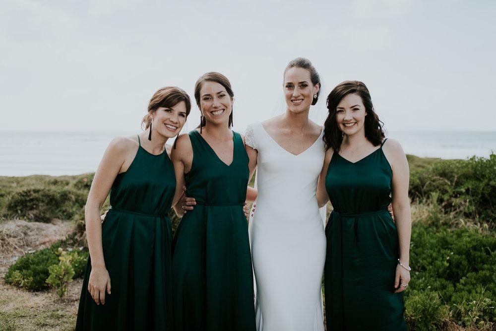 Bride with bridesmaids on Katikati beach before wedding day