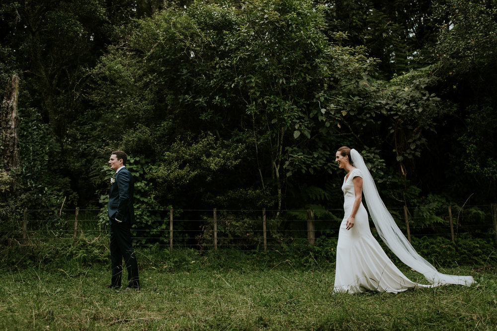 Kiwi bride and groom walking towards each other during first look