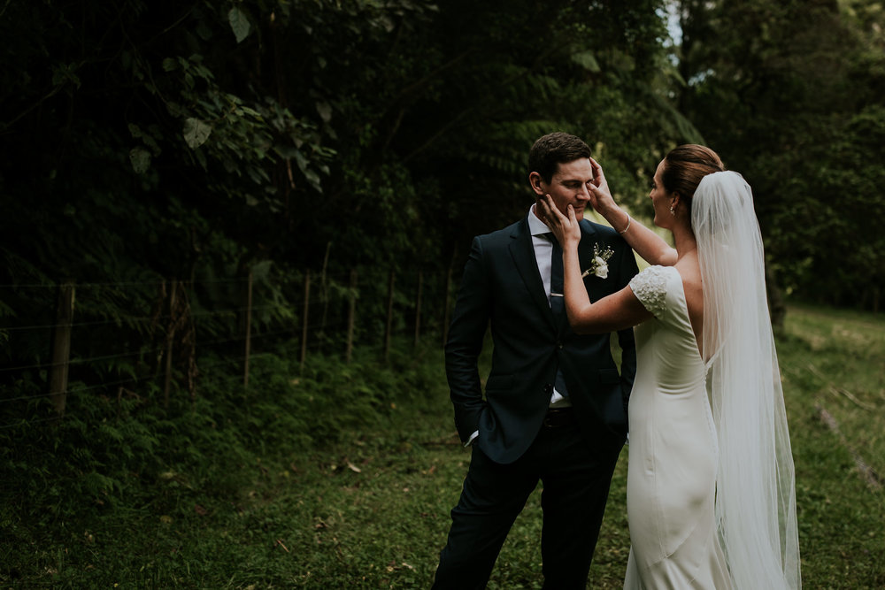 Bride wiping grooms tears away during emotional first look in New Zealand