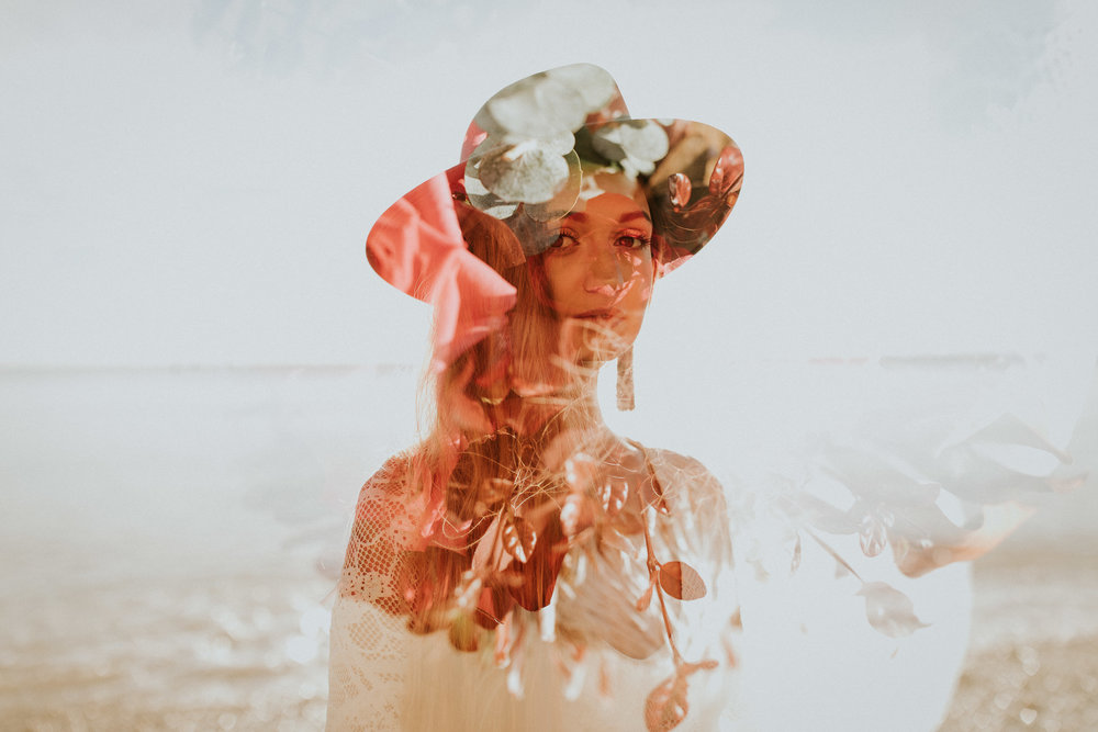 Double exposure floral portrait wearing Grace Loves Lace dress on New Zealand beach