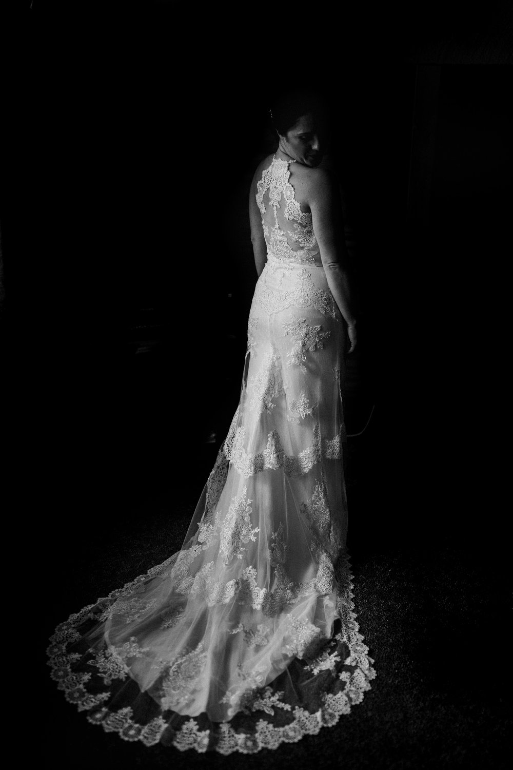 Black and white bridal portrait of bride wearing gown at fairmont hot springs wedding