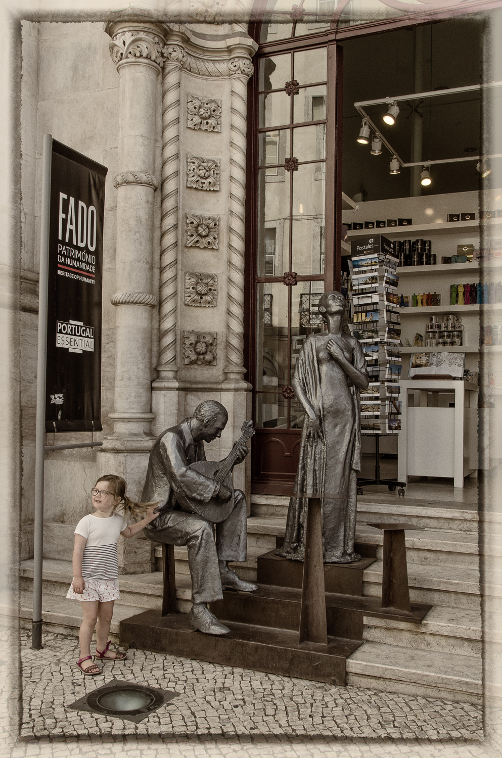 LIttle Girl with Fado Statues
