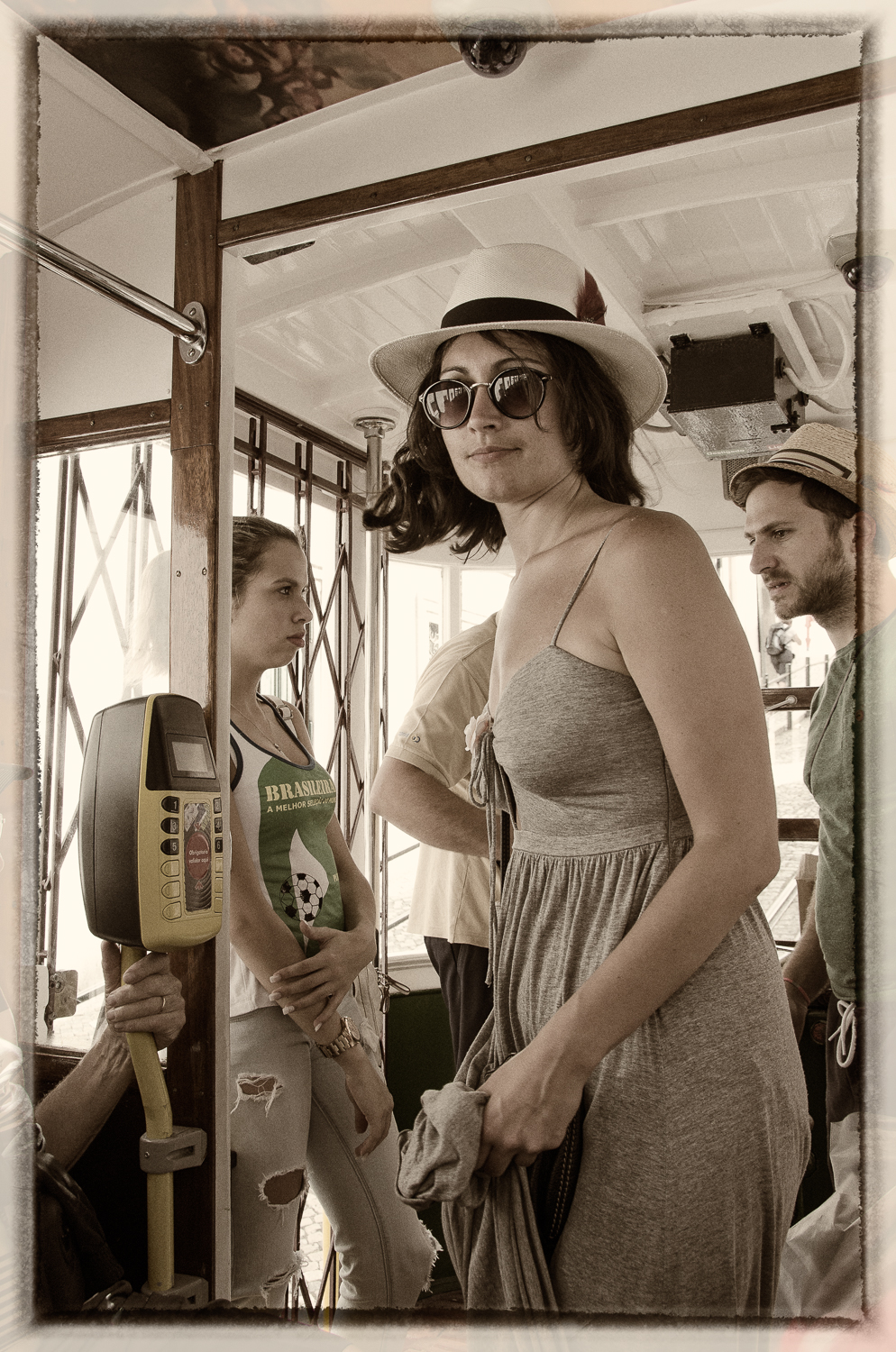 Woman in Hat on the Glória Funicular