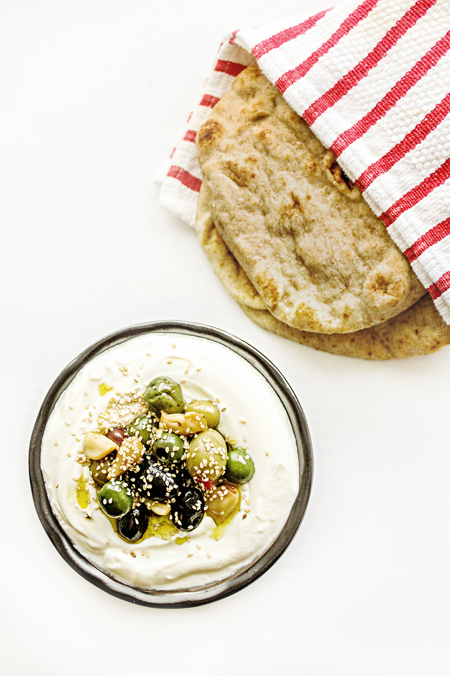 Organic Valley Grassmilk Yogurt Dip with Warm Mixed Olives, Sesame Seeds, and Roasted Garlic | Photograph  © Cheryl Sternman Rule
