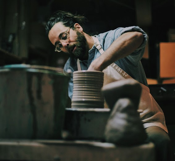 Boston Ceramicist Jeremy Ogusky at his potter's wheel.