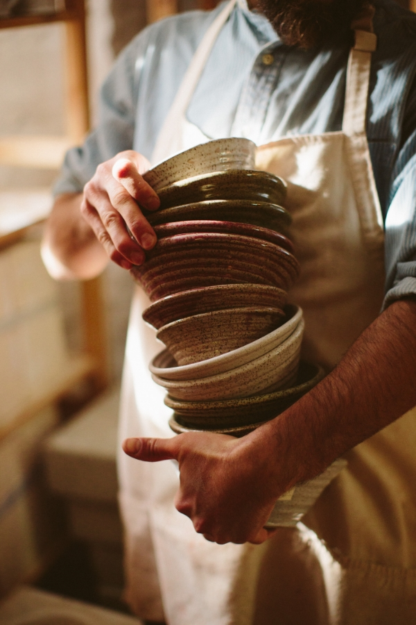 Jeremy Ogusky with a Collection of His Bowls | Photograph © Brian Samuels Photography