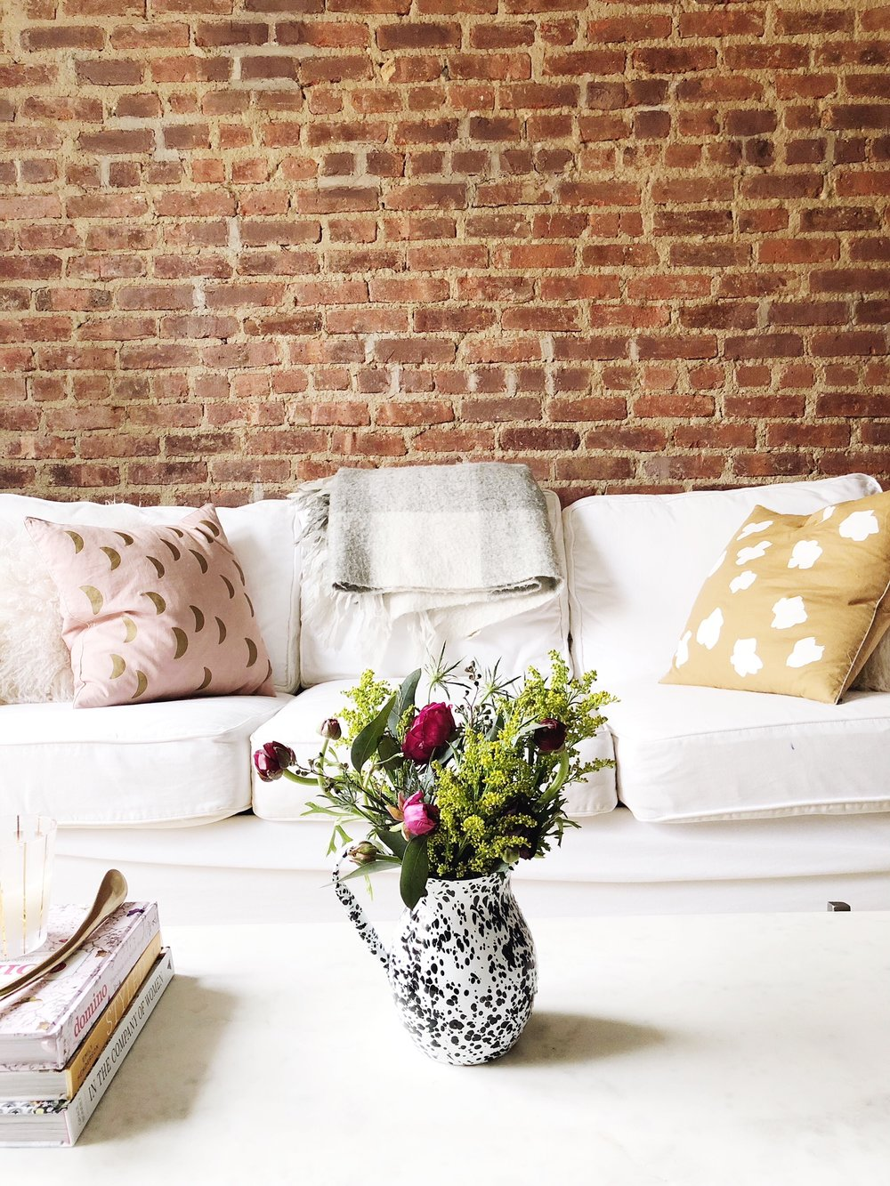TGA Couch Exposed Brick.JPG