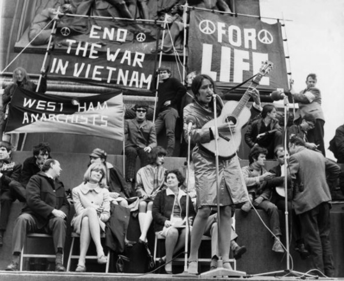 Joan Baez plays in Trafalgar Square, during a protest organised against the war in Vietnam in 1965 Photograph: Keystone-France/Gamma-Keystone via Getty Images