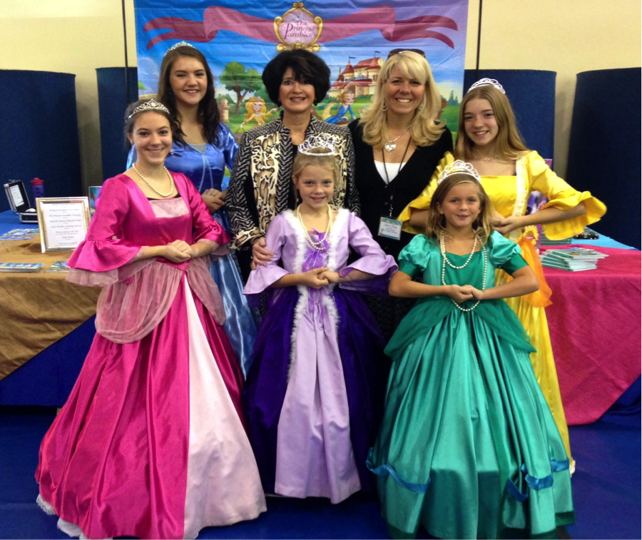 Jackie (left) and Jeanna (right) with a gaggle of princesses.