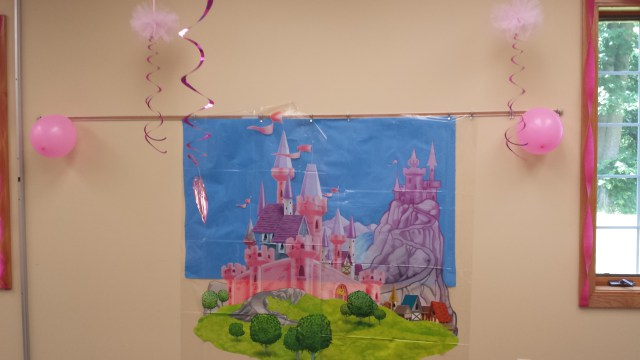 This castle decoration was so pretty! It stands about 5′ tall and made a great backdrop for pictures. It is in two pieces that don't align perfectly, so you have to line them up yourself. I used double-sided tape, which worked well.