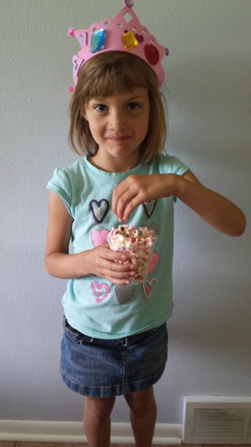 Here's my little princess Skyler with her tiara and popcorn.