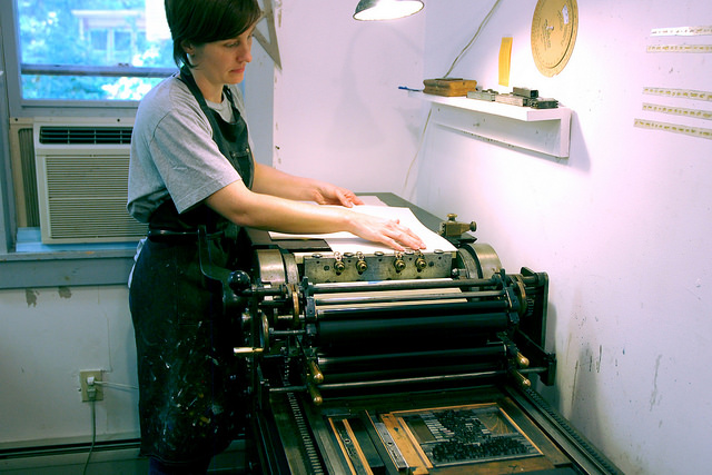 Leslie Nichols printing in the letterpress studio at  Women's Studio Workshop