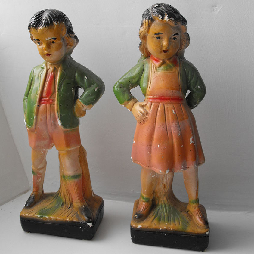 Chalkware boy and girl
