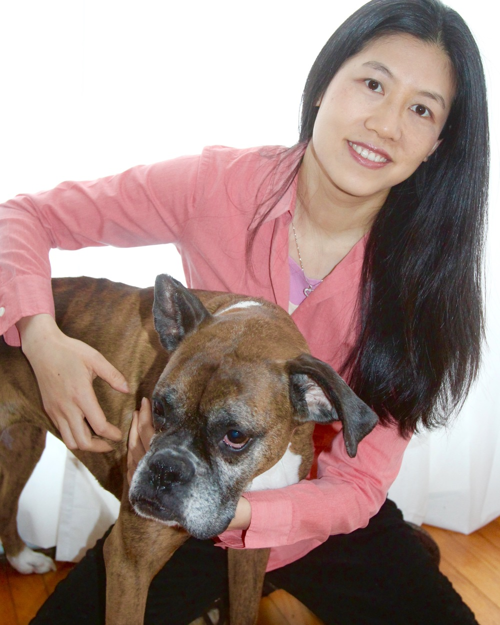 Dr. Nancy ying with Bella, her acupuncture patient