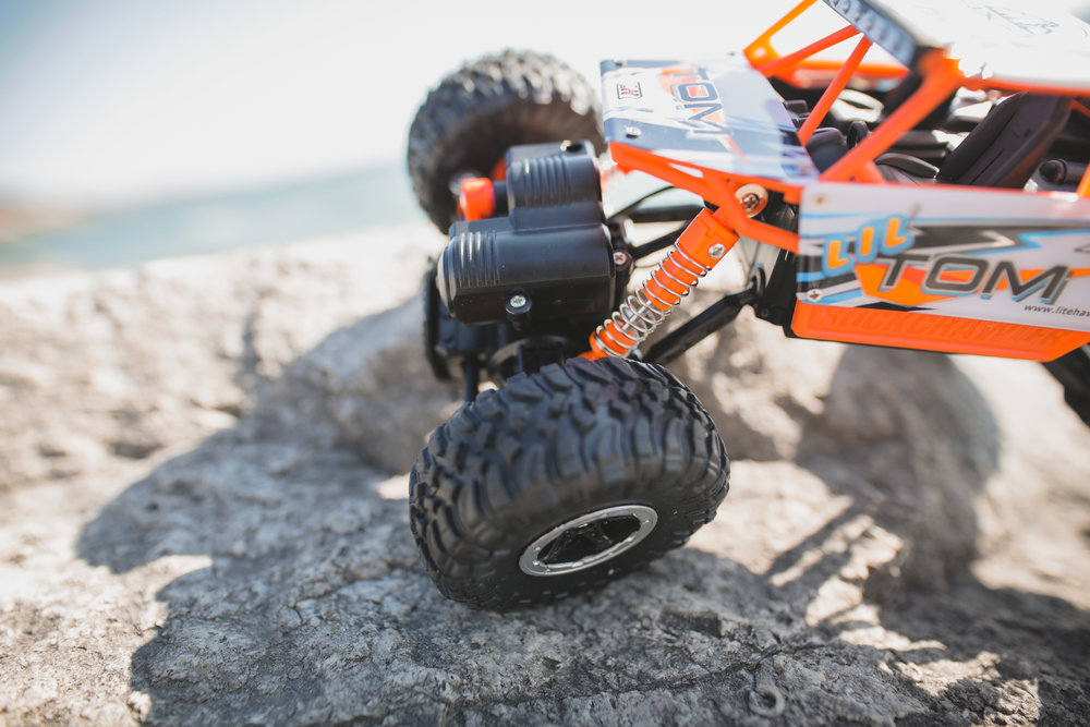 Oversize Wheels and Suspension - LIL TOM can handle challenging terrain with ease - crawl over rocks, or speed over smaller obstacles.