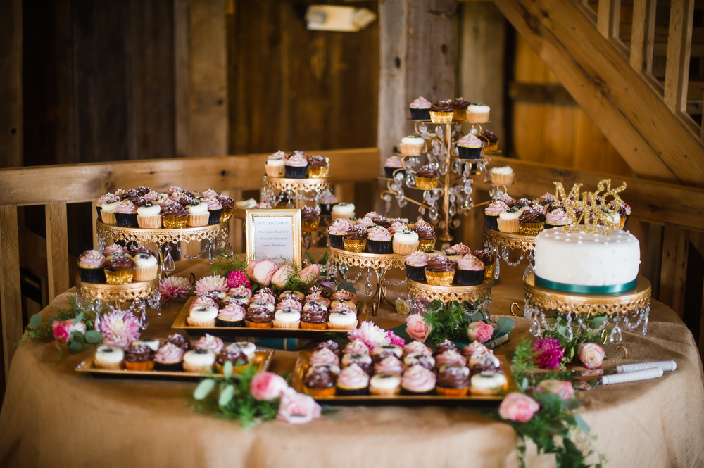small wedding cake and cupcakes including champagne raspberry and chocolate cinnamon flavors (photo courtesy of sky's the limit photography)