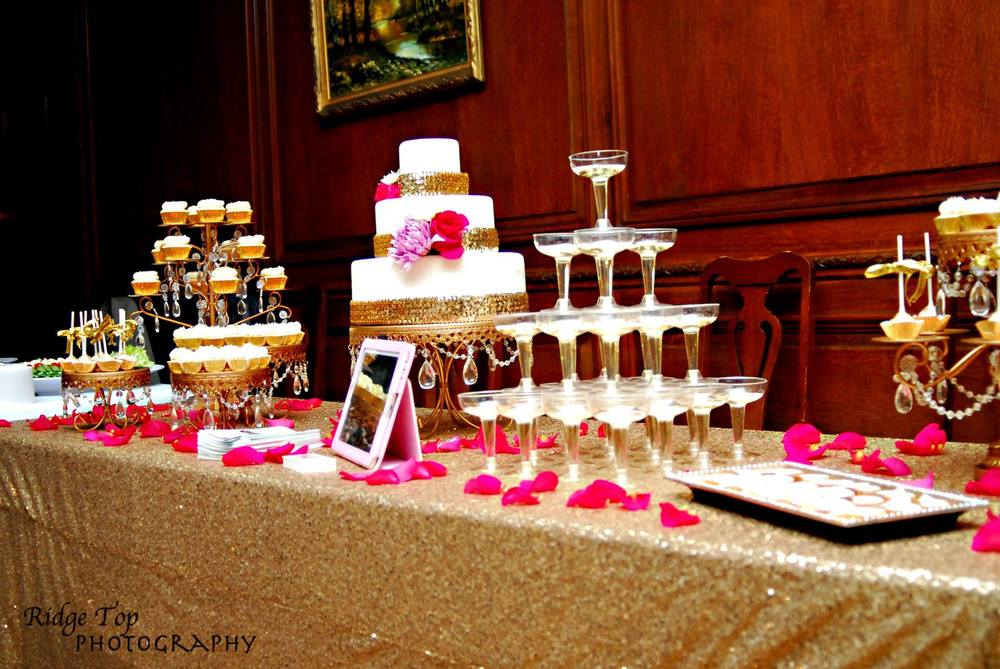 an elegant wedding display featuring  custom cakes, cupcakes, and cake pops (photo courtesy of ridge top photography)