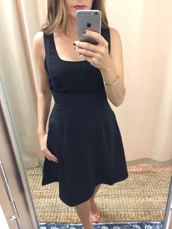 IT'S HARD TO TELL BECAUSE I AM WEARING A BLACK TOP - BUT THIS IS A PINAFORE STYLE DRESS.  WOULD LOOK SUPER CUTE WITH A TURTLENECK OR BOWTIE BLOUSE.