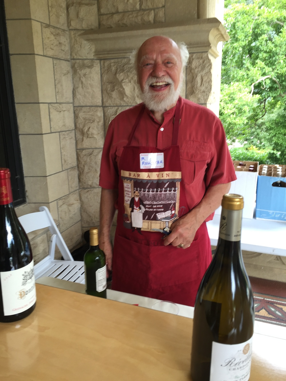 AFO Board Member Mark Rousseau, happy to serve vin blanc ou rouge!