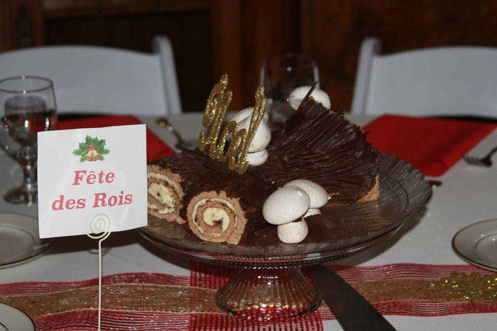 Beautiful Buche de Noël on each table made for a wonderfully festive evening.