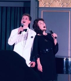 Anne-Marie sings a duet with Maître de Cérémonie Danny Denenberg.