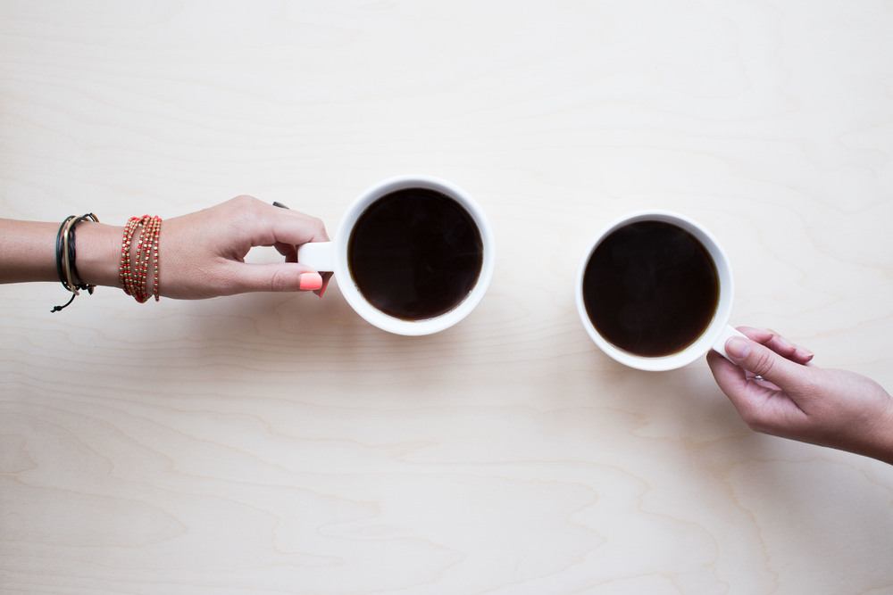 Treating a friend to a cup of coffee is one example of simple act of kindness.