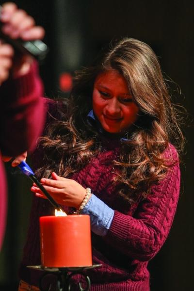 Senior Debbie Pinto lights Union's Sabbath candle. | PC: Marketing Communications