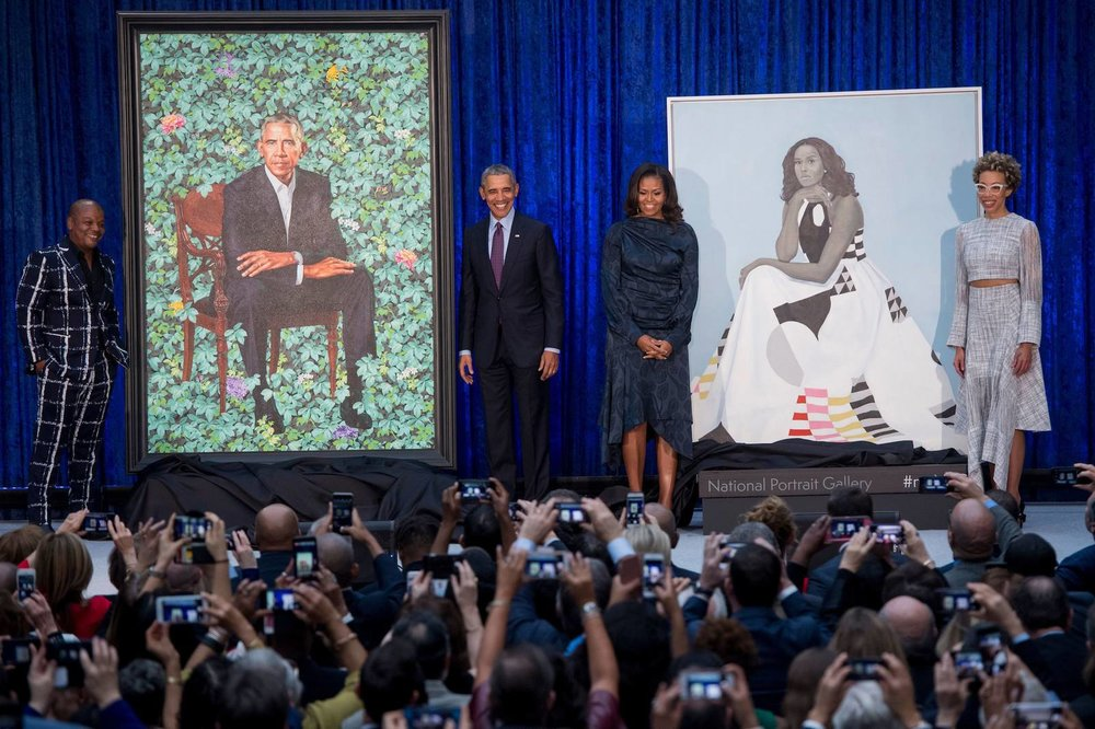 Former US President Barack Obama and First Lady Michelle Obama with their portraits and their respective artists Kehinde Wiley and Amy Sherald | PC: Saul Loeb—AFP/Getty Images