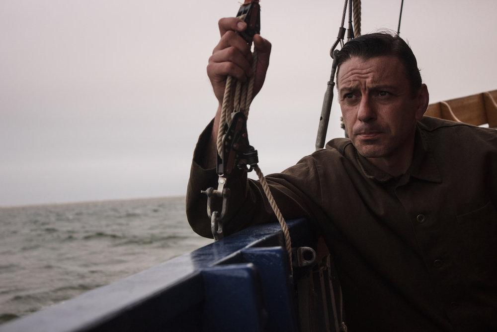 Enzo Cilenti at sea wearing UNITE cologne from Thomas Clipper