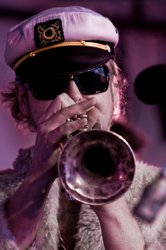'Papa' Lovebone Playing Trumpet in His Captain's Hat