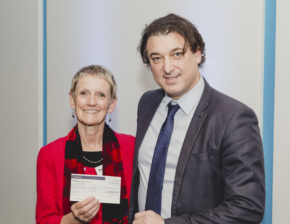 [Jeffrey Young, CEO and Founder of The Allegra Foundation is handing over a cheque for Project Waterfall: Tanzania to Barbara Frost, the CEO of WaterAid].