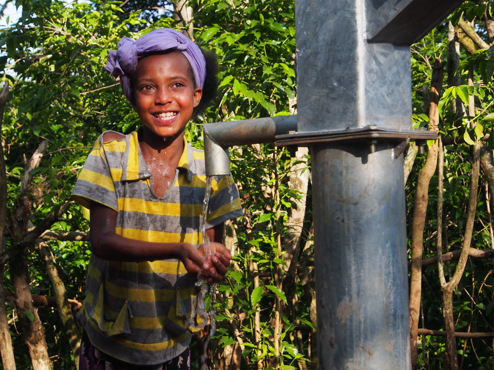 Martha Tesfaye, 9, enjoys washing with clean water for the first time in her life [Photo: WaterAid/ Behailu Shiferaw/ Ethiopia]