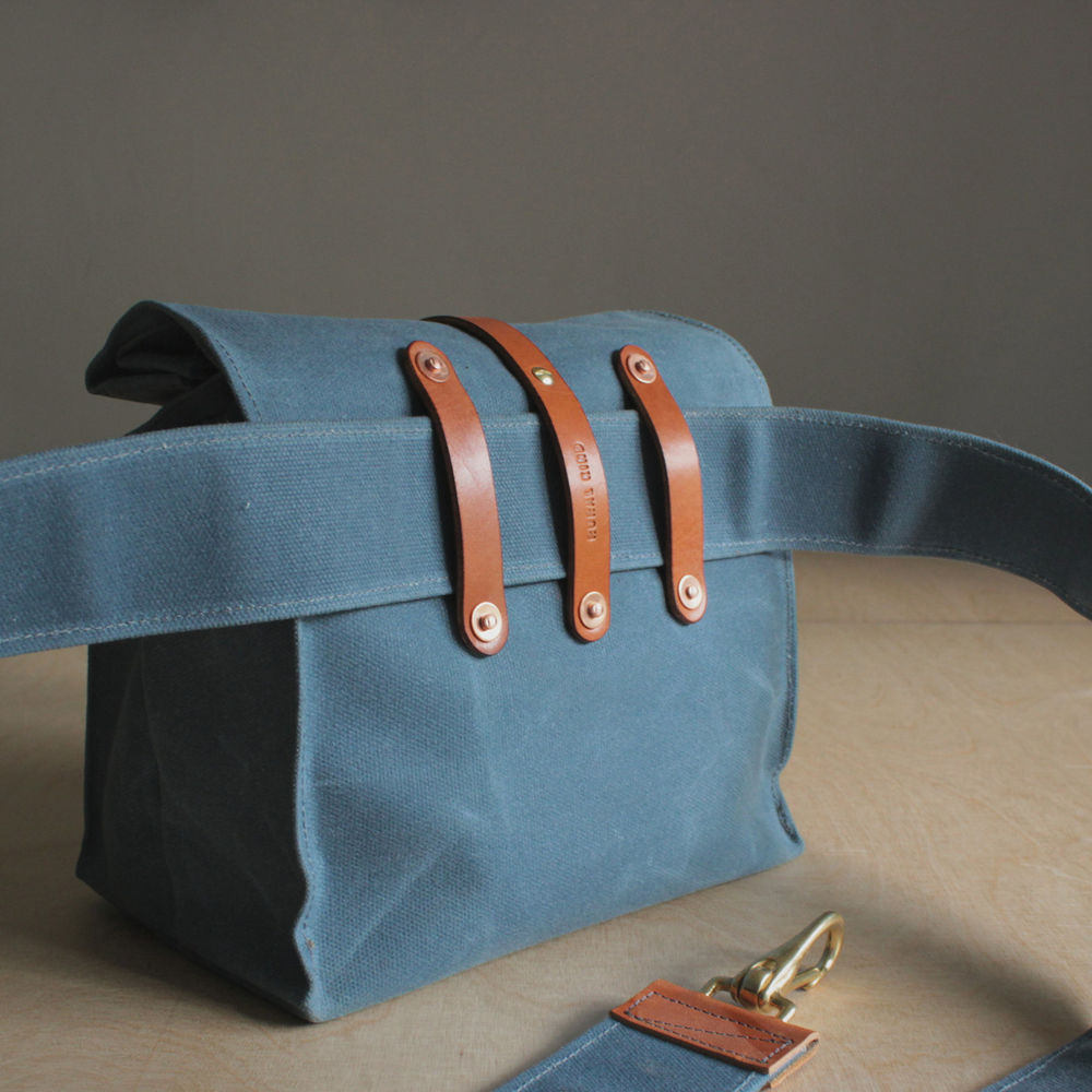 Back detail (really love these little leather strap holders). The strap is removable so you can feed the bag onto your belt if so inclined!