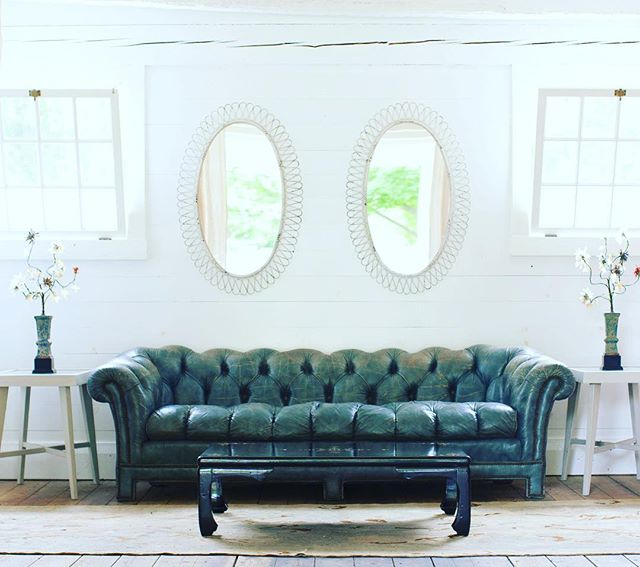 We are in L.O.V.E. with this marine blue leather tufted chesterfield sofa...as worn in and comfortable as your favorite pair of jeans #cloverdesign #vintagefurniture #chesterfield #tufted #leather #findyourclover