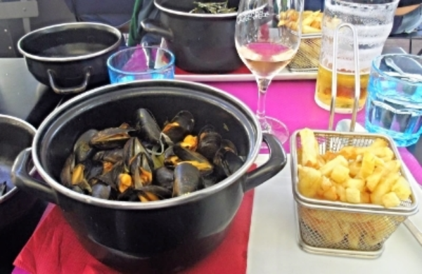 Moules - frites  at a quayside restaurant in the Old Port, La Rochelle
