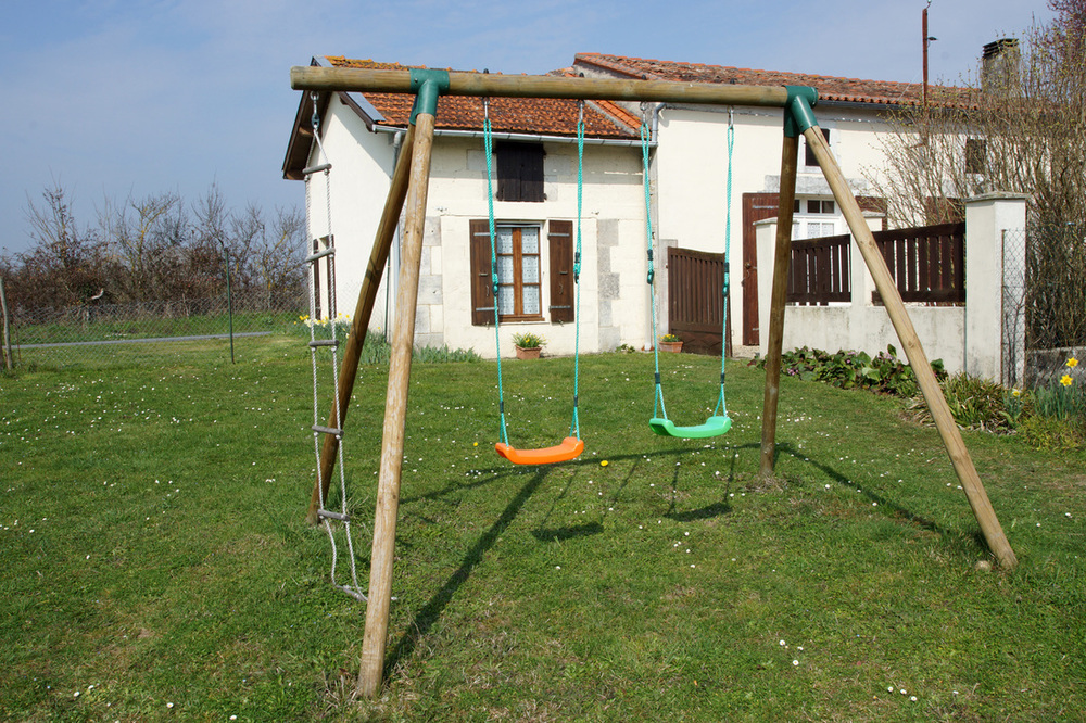Play area with swings