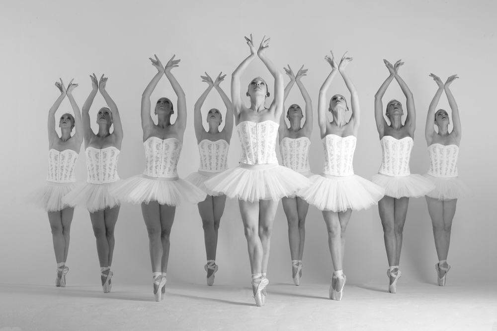 Classical Ballet in white on pointe, Divine Company.jpg