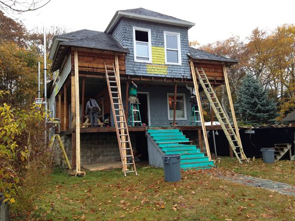 Hey — remember this? A photo of the house taken six months ago by homeowner Will Crosby shows the early demolition phase of the work.