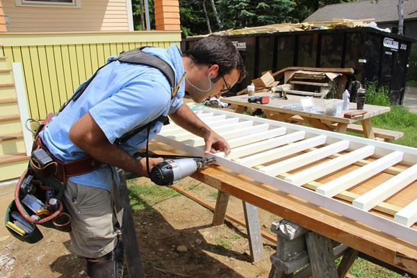Pollard pins the top ends of the balusters to the sub-top-rail with three 15-gauge stainless steel nails.