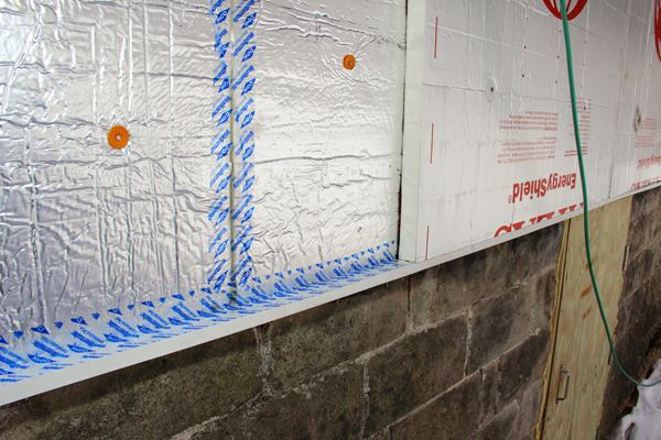 A closer view of the foam installation detail shows the inner layer of foam, sealed with Dow Weathermate tape, topped with a second layer of 1.5-inch foam.