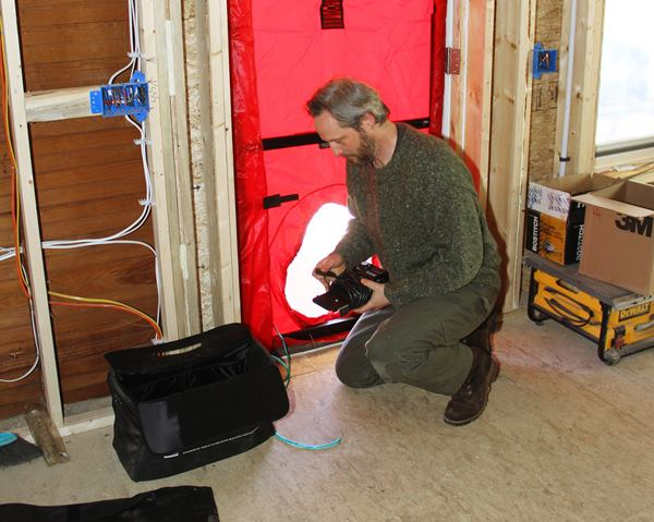 Harvey Johnson sets up the blower door.