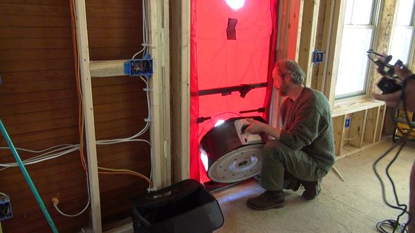 Installing the blower door fan into the door.