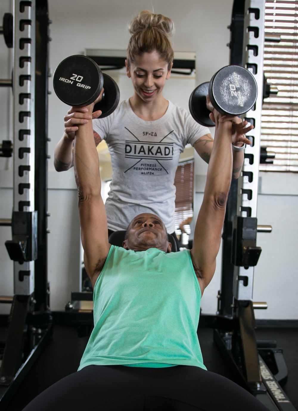 DIAKADI Trainer Nicolette Amarillas spotted chest press.jpg