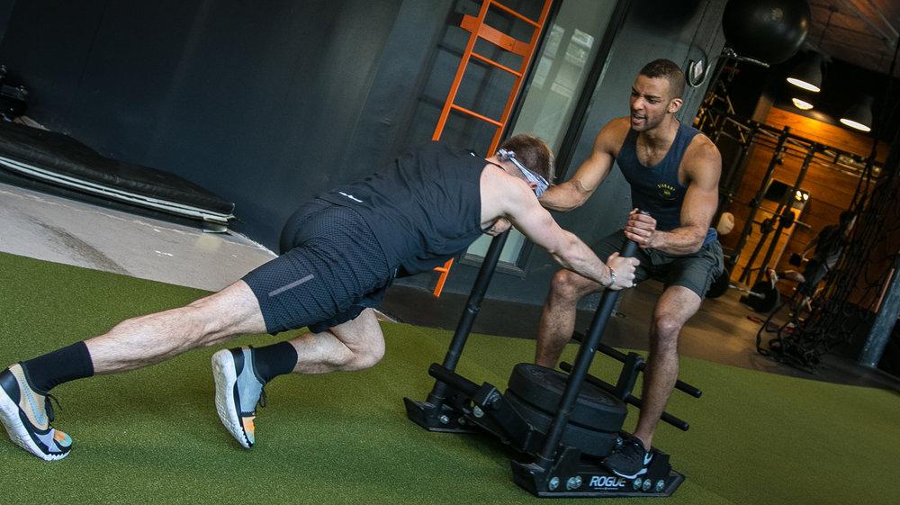 DIAKADI Trainer Joe Andrews sled push high intensity.jpg