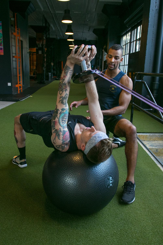 DIAKADI Trainer Joe Andrews coaching strength and stability.jpg