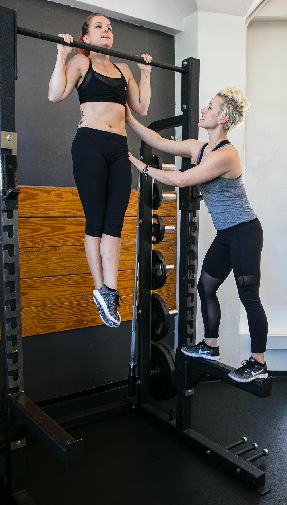 DIAKADI Trainer Natalie Carey coaching pull ups.jpg