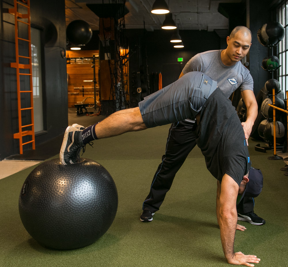 DIAKADI Trainer Derrick Lee swissball core work.jpg